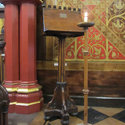 Photograph of the wooden lectern with plaque in King's College Chapel