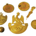 Byron's collection of Waterloo spoils including  a French soldier's shot and cap badge.