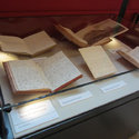 Photograph of exhibition case 1 showing books and manuscripts.