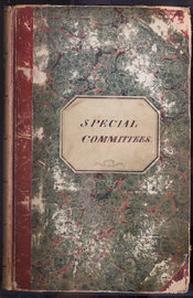 A picture of the front cover of the Special Committee book for the years FIND. The book has a red spine with green circular patterns and an imprinted title.