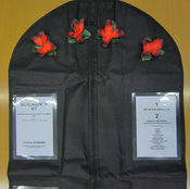 Schengen's kit, comprising a zippered black bag with red cloth poppies and panels of instructive text