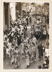 Photograph of coronation celebrations in Hong Kong, showing the procession, with a float decorated with a dragon