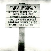 A warning sign that reads taking photos is not allowed, in four languages: English, French, Russian and German