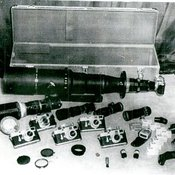 Confiscated BRIXMIS Equipment including a long lense camera, and assortment of maps and cameras as well as film