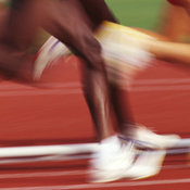 generic images of the legs of runners competing in a race