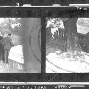Two pictures of two Communist agents removing a map and film from a hollow spot in a stone fence