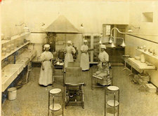 This is a black and white photograph of nurses in St Thomas' Hospital North Theatre, 1909