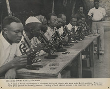 Photograph of a team of African microscopists at work