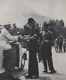 A British policeman and his Spanish counterpart at the frontier in Gibraltar, with the Rock of Gibraltar in the background