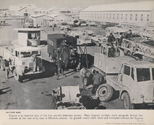 Photograph showing the new British army base at Dhekelia, with military vehicles and buildings visible, and men working