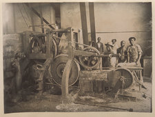Photograph showing indigenous people involved in the manufacture of sisal hemp, with farming machinery
