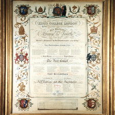 Photograph of a large paper document recording the first meeting of King's College London with members listed for the Provisional Committee, first council and first professors the border is filled with coloured images such as coats of arms and symbols, such as the beehive, the crown and clerical regalia such as a mitre relating to King's, while at the bottom is a drawing of Smirke's design for the main building
