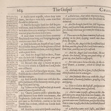 The second chapter of Luke's Gospel, describing the birth of Christ, showing the Rheims Bible text (left-hand column) and the Bishops' Bible text (right-hand column).