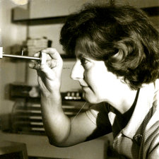 Jean Hanson holding a metal rod used for experiments