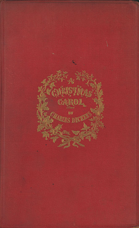 front cover in red cloth with title and decoration stamped and tooled in gold front cover of a christmas carol originally published 1843 - When Was A Christmas Carol Published